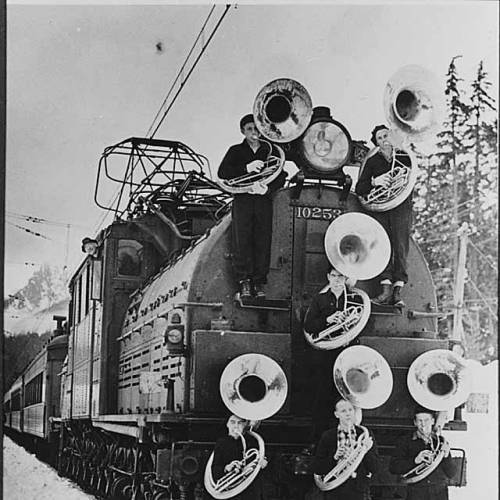 Members of Franklin High School band with train, Snoqualmie Pass, January 1938. Washington.